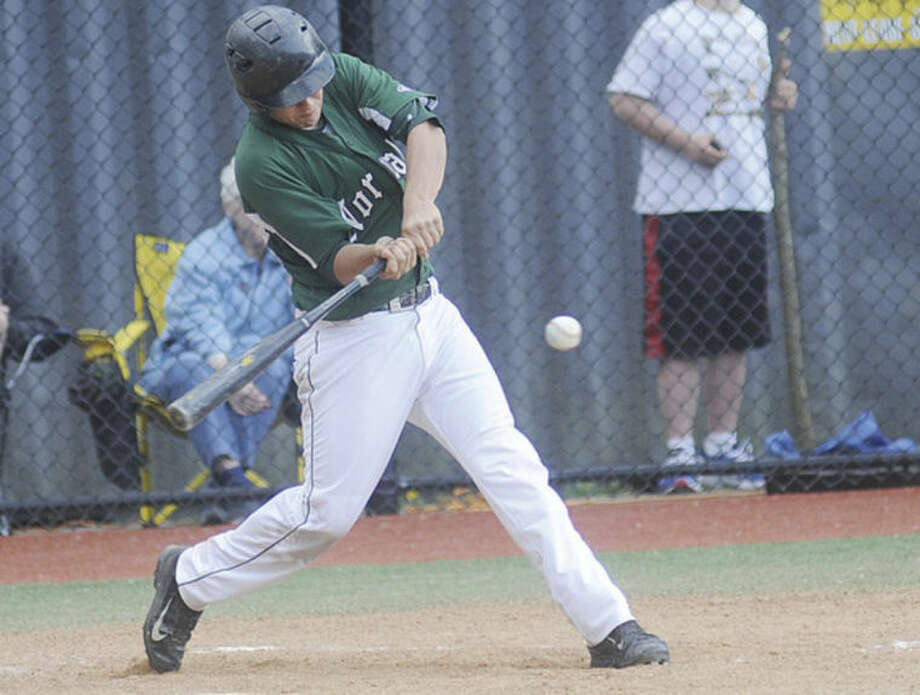 Hour photo/Matthew VinciNorwalk's Ryan Evans hits a two run double during Monday's game against Darien. Norwalk has two win two of its last three games to make it into the state tournament.