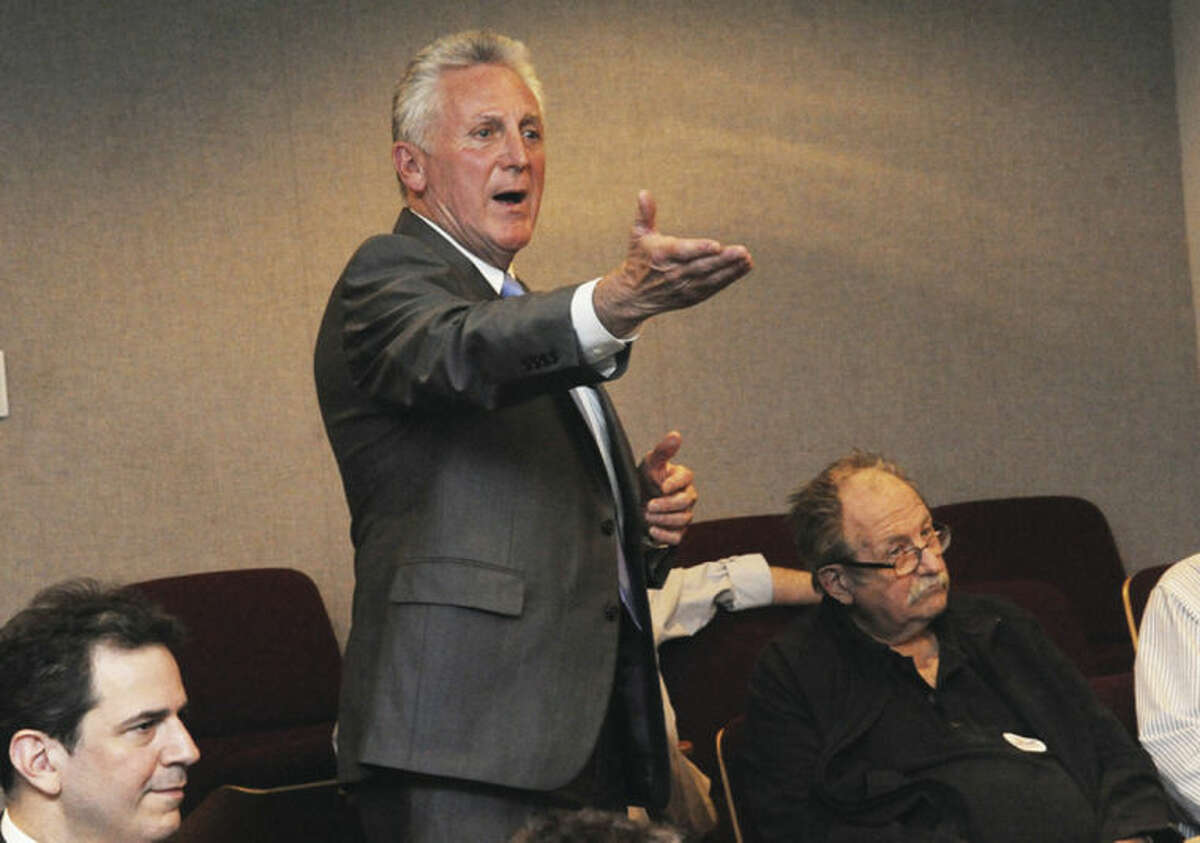 Hour photo / Matthew Vinci Norwalk Mayor Harry Rilling nominates Bob Duff for re-election to the State Senate District 25 seat Monday at Norwalk City Hall.