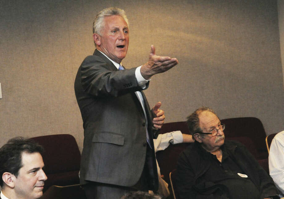 Hour photo / Matthew VinciNorwalk Mayor Harry Rilling nominates Bob Duff for re-election to the State Senate District 25 seat Monday at Norwalk City Hall.