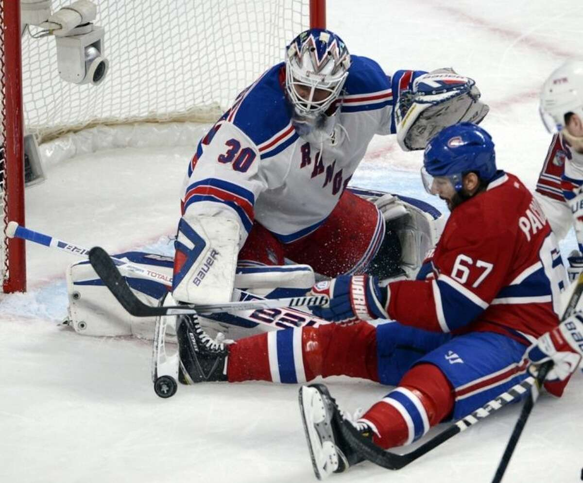 Montreal Canadiens left wing Max Pacioretty (67) is stopped by New York Rangers goalie Henrik Lundqvist (30) during first period in game two of the NHL Eastern Conference final Stanley Cup playoff action Monday, May 19, 2014, in Montreal. (AP Photo/The Canadian Press, Ryan Remiorz)