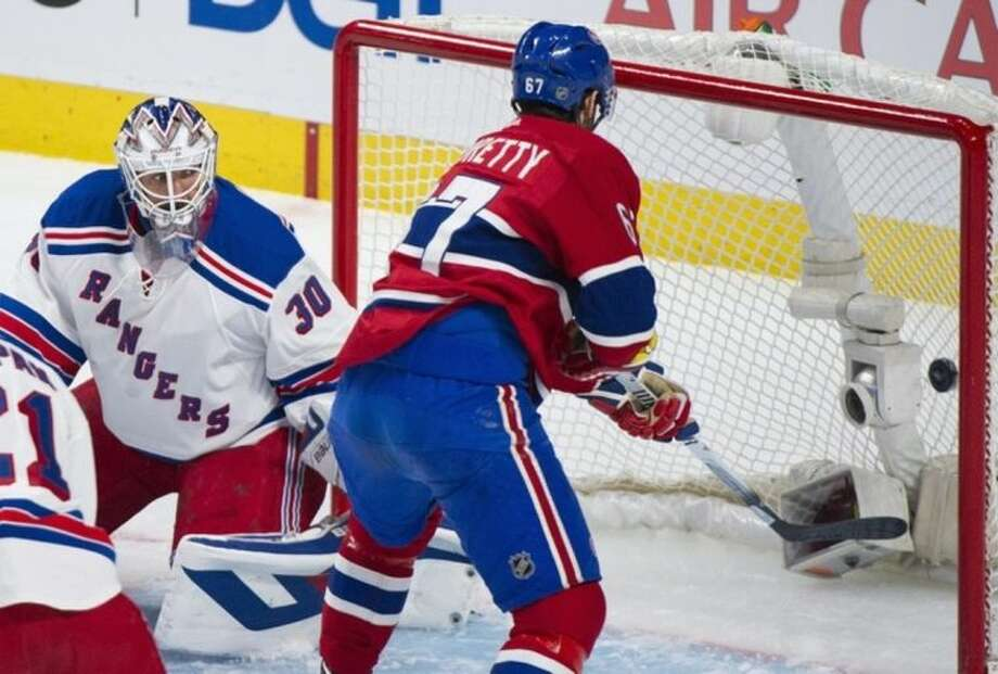 Montreal Canadiens' Max Pacioretty, right, scores on New York Rangers goalie Henrik Lundqvist during the first period in the NHL Eastern Conference final Stanley Cup playoff game Monday, May 19, 2014, in Montreal. (AP Photo/The Canadian Press, Graham Hughes)