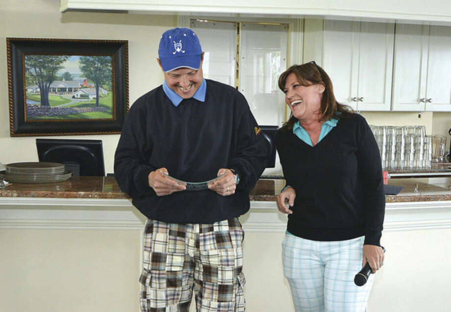 Hour Photo/Alex von KleydorffWally Dunn recives a plaque as he is honored on his retirement by Denise Vuoso.