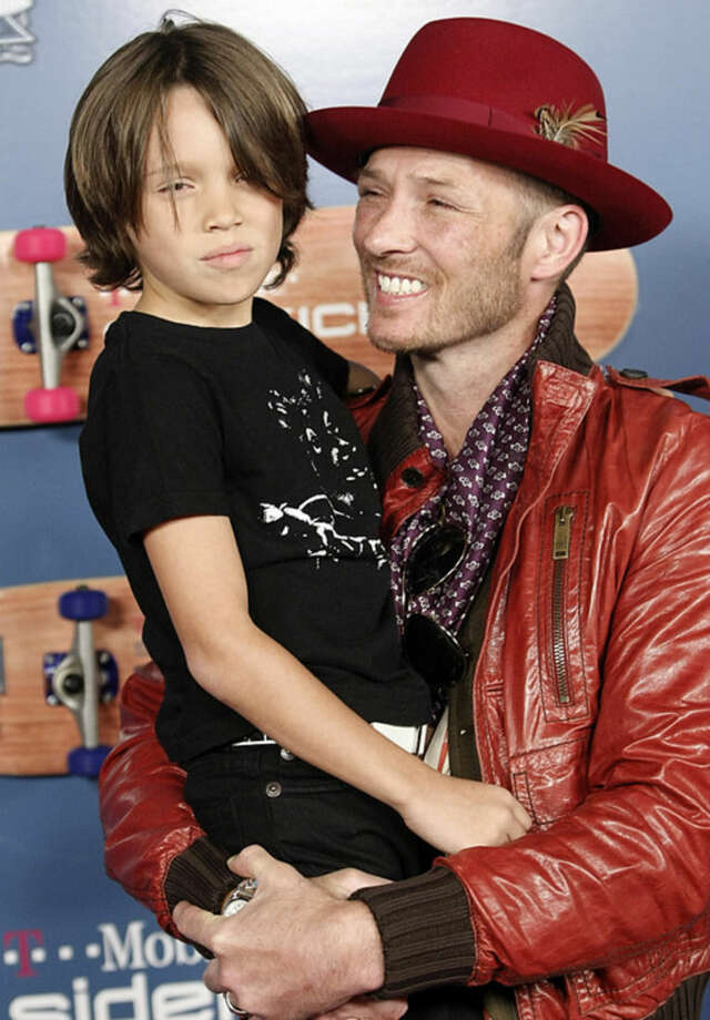 FILE - In this Aug. 1, 2008, file photo, singer Scott Weiland, right, and his son Noah Weiland pose on the press line at the T-Mobile Sidekick LX Tony Hawk Edition Party in Los Angeles. Weiland, the former frontman for the Stone Temple Pilots and Velvet Revolver, has died. He was 48. The singer's manager confirmed the death to The Associated Press early Friday, Dec. 4, 2015. (AP Photo/Dan Steinberg, File)