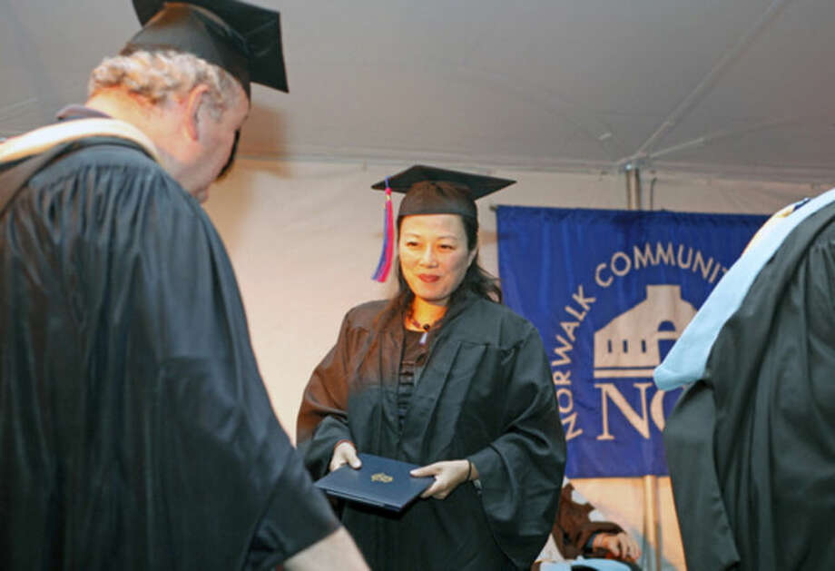 Yong Yang receives her diploma durng the 52nd Annual Commencement Excercise at Norwalk Community College Thursday afternoon.Hour Photo / Danielle Calloway