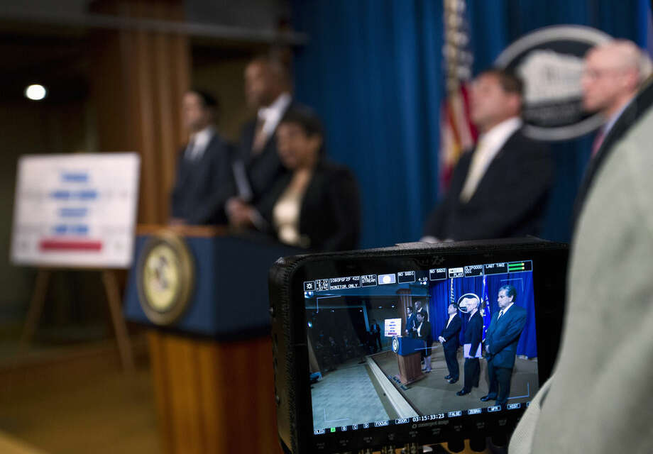 """Attorney General Loretta Lynch speaks during a news conference at the Justice Department in Washington, Thursday, Dec. 3, 2015, to discuss the FIFA corruption case. Five current and former members of FIFA's ruling executive committee were among 16 additional men indicted on corruption charges Thursday as part of U.S. prosecutors' widening investigation into soccer corruption. Lynch said. """"The scale of corruption alleged herein is unconscionable."""" (AP Photo/Jose Luis Magana)"""