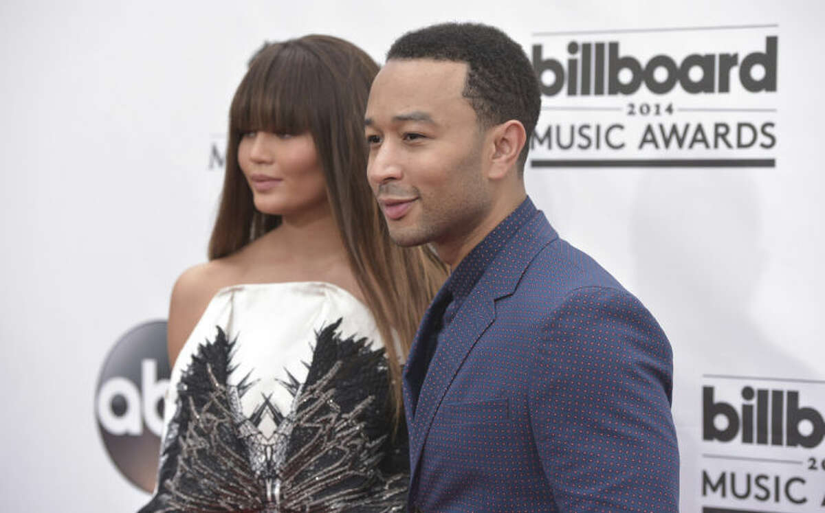 Chrissy Teigen, left, and John Legend arrive at the Billboard Music Awards at the MGM Grand Garden Arena on Sunday, May 18, 2014, in Las Vegas. (Photo by John Shearer/Invision/AP)