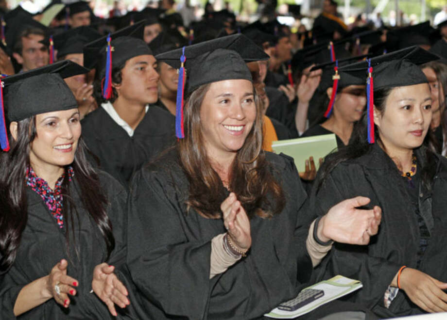 Vanessa Scialpi applaudes durng the 52nd Annual Commencement Excercise at Norwalk Community College Thursday afternoon.Hour Photo / Danielle Calloway