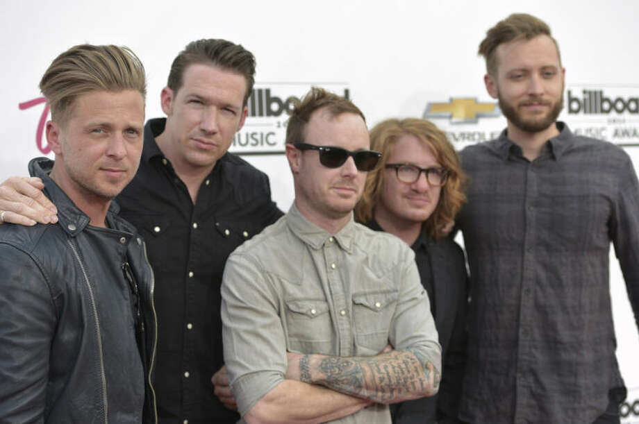 Ryan Tedder, from left, Zach Filkins, Eddie Fisher, Drew Brown and Brent Kutzle of the musical group OneRepublic, arrive at the Billboard Music Awards at the MGM Grand Garden Arena on Sunday, May 18, 2014, in Las Vegas. (Photo by John Shearer/Invision/AP)