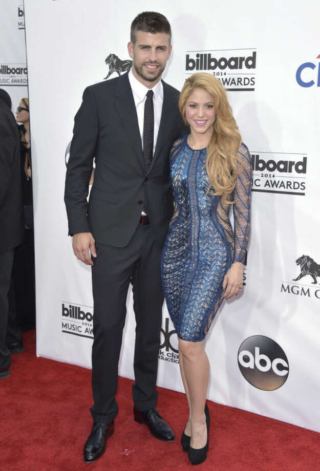 Gerard Pique, left, and Shakira arrive at the Billboard Music Awards at the MGM Grand Garden Arena on Sunday, May 18, 2014, in Las Vegas. (Photo by John Shearer/Invision/AP)