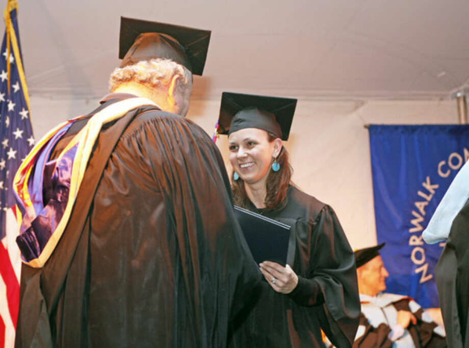 Anna Dlugokecka receives her diploma durng the 52nd Annual Commencement Excercise at Norwalk Community College Thursday afternoon.Hour Photo / Danielle Calloway