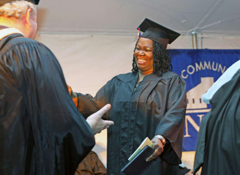 Alcyon Ellam receives her diploma durng the 52nd Annual Commencement Excercise at Norwalk Community College Thursday afternoon.Hour Photo / Danielle Calloway
