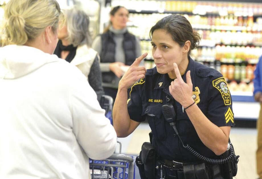 "Hour Photo/Alex von KleydorffDuring a ""Purse Patrol,"" Norwalk Police Sgt. Sofia Gulino talks about the 'Keep an Eye On Your Purse' sticker and keeping your purse secure."