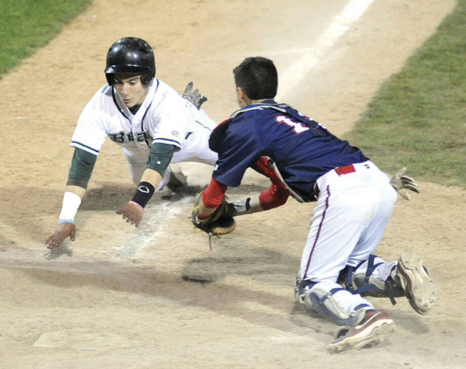 Hour photo/John NashNorwalk's Jessie Rodriguez, left, is tagged out at the plate by Brien McMahon catcher Hunter Dumas during the third inning of Wednesday night's city rivalry showdown at The Ballpark at Harbor Yard in Bridgeport.