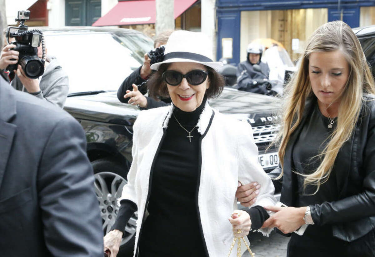 Mary Jo Shannon, grandmother of Kim Kardashian, arrives at Kanye West's Paris apartment, Tuesday, May 20, 2014. The gates of the Chateau de Versailles, once the digs of Louis XIV, will be thrown open to Kim Kardashian, Kanye West and their guests for a private evening this week ahead of their marriage. (AP Photo/Jacques Brinon)