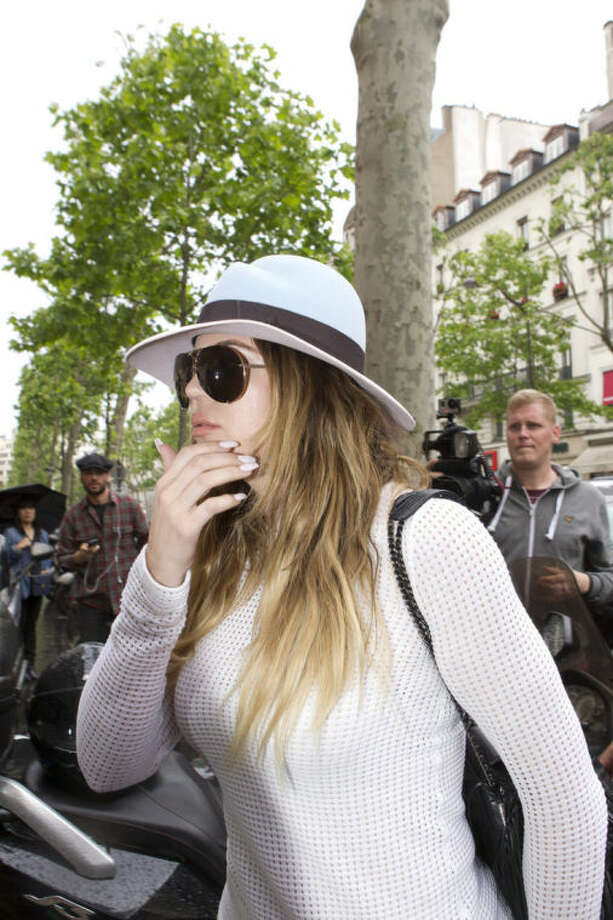 Khloe Kardashian, sister of Kim Kardashian, arrives at Kanye West's Paris apartment, Tuesday, May 20, 2014. The gates of the Chateau de Versailles, once the digs of Louis XIV, will be thrown open to Kim Kardashian, Kanye West and their guests for a private evening this week ahead of their marriage. (AP Photo/Jacques Brinon)