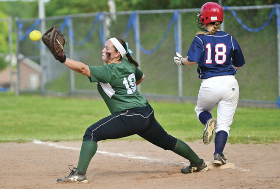 Hour photo/Erik TrautmannMallory Rochefort of Norwalk High gets a late throw as McMahon's Sam Ruess comes into first safe in their intracity softball game Wednesday