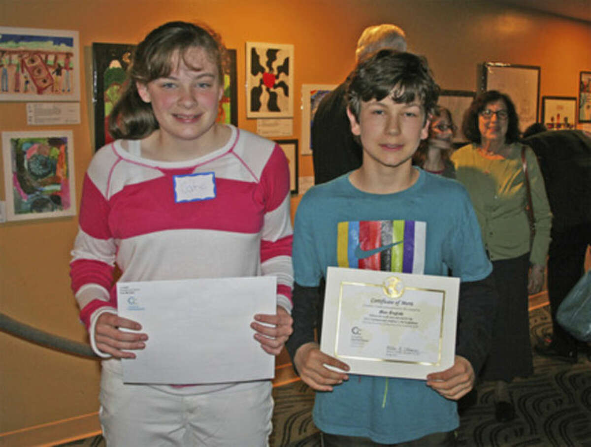 Contributed photo Cate McCabe and Max English, both 12 and both students at Middlebrook School in Wilton, hold their Certificates of Merit during the reception for the 18th International Children's Art Show, open now through Sept. 1 in The Maritime Aquarium at Norwalk's IMAX Theater lobby. A third Middlebrook student whose drawing is displayed, Alex Myers, was unable to attend the reception. Get details about the art show and all of the Aquarium's exhibits and IMAX movies this summer at www.maritimeaquarium.org.