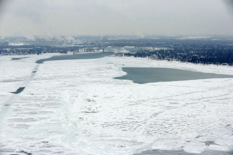 In this Feb. 6, 2014 aerial photo is a view of Lake Huron looking south towards Port Huron, Mich., right, and Sarnia, Ont., left. This winter has been so bitterly cold for so long that the sprawling Great Lakes, which hold nearly one-fifth of the surface fresh water in the world, may freeze over for the first time in two decades. (AP Photo/Carlos Osorio)