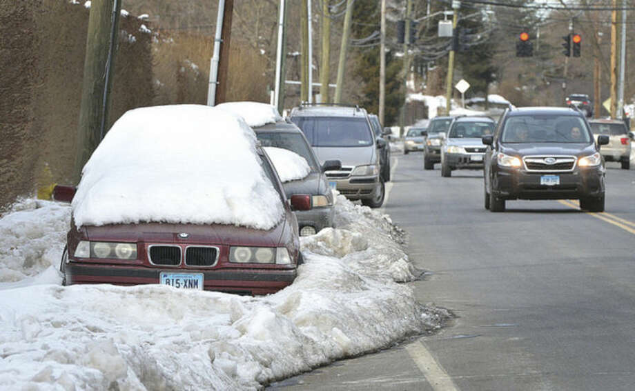 Hour Photo/Alex von Kleydorff Cars are frozen in their parking spots on the side of the road in Norwalk Wednesday
