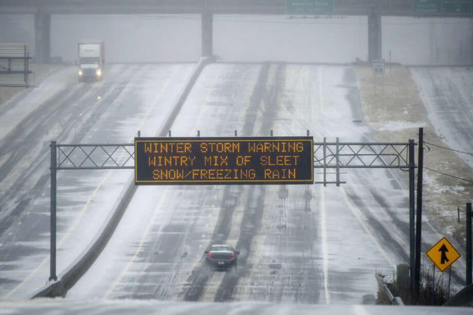 A Georgia DOT sign warns drivers of winter weather as they travel a bleak section of Hwy. 141 on Wednesday, Feb. 12, 2014, in Norcross, Ga. The scene is the opposite of what drivers experienced two weeks ago when every major artery of metropolitan Atlanta was clogged during the last winter storm. (AP Photo/John Amis)