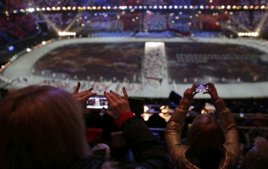 AP Photo/Charlie Riedel, FileFILE - In this Friday, Feb. 7, file photo, a spectator takes a video of the opening ceremony on her mobile phone at the 2014 Winter Olympics in Sochi, Russia.