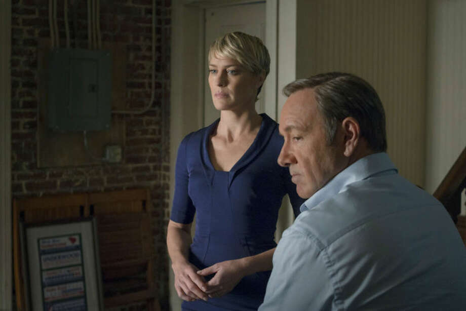 "This image released by Netflix shows Robin Wright as Clair Underwood, left, and Kevin Spacey as Francis Underwood in a scene from ""House of Cards."" The second season of the popular original series premieres on Friday, Feb. 14, 2014 on Netflix. (AP Photo/Netflix, Nathaniel E. Bell)"