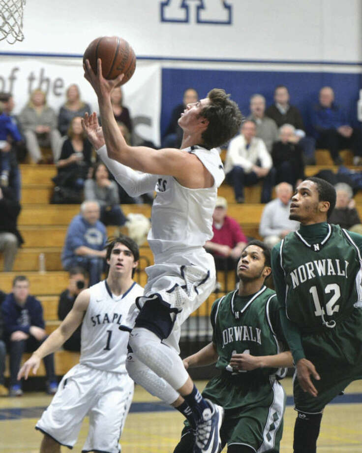 Hour photo/Alex von KleydorffDavid Katz of Staples goes up for a shot during Monday night's game against Norwalk in Westport. Katz and the Wreckers scored a 72-66 victory.
