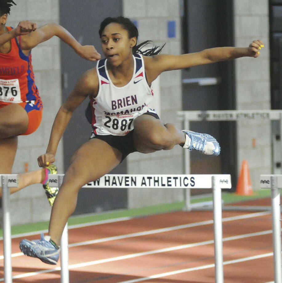 Sarah Boydof Brien McMahon clears a hurdle during her 55-meter hurdles heat race at Monday's State Open Track Championship meet in New Haven. Boyd went on to finish second in the final.Hour photo/ John Nash