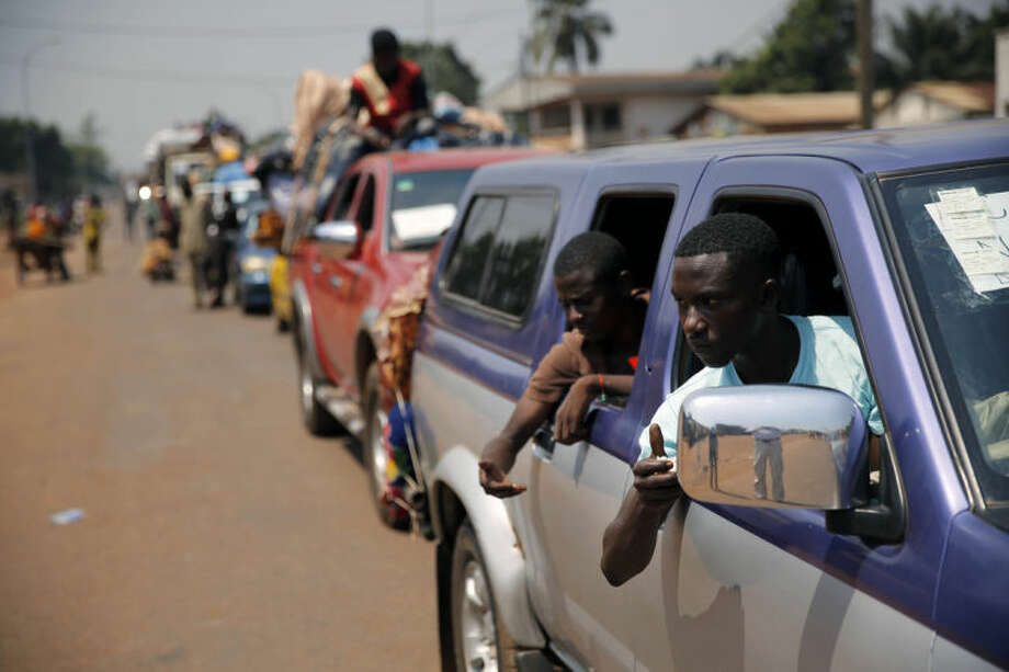 A convoy of over 100 vehicles of Muslims who are fleeing Bangui, turn around as Misca troops deemed that the road out was not secure, in Bangui, Central African Republic, Friday Feb. 14, 2014. The convoy, which stretched as far as the eye could see, was turned back because peacekeepers feared it would be attacked when going through some volatile parts of Bangui. (AP Photo/Jerome Delay)