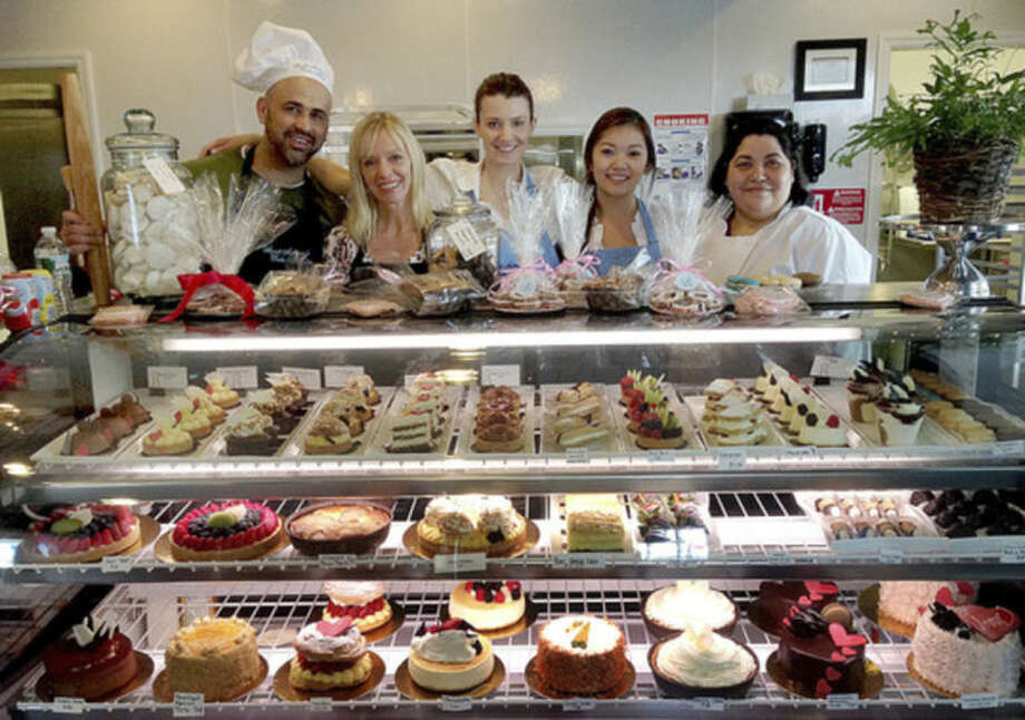 Hour photo/Chris BosakThe staff at Sweet Sabrina's Cake Shop includes (left to right): Colbert Dasilva, executive pastry chef; Vera Pastorello, owner and chef; Alex Mirbach; Sabrina Pastorello; and Aime Ocegueda.