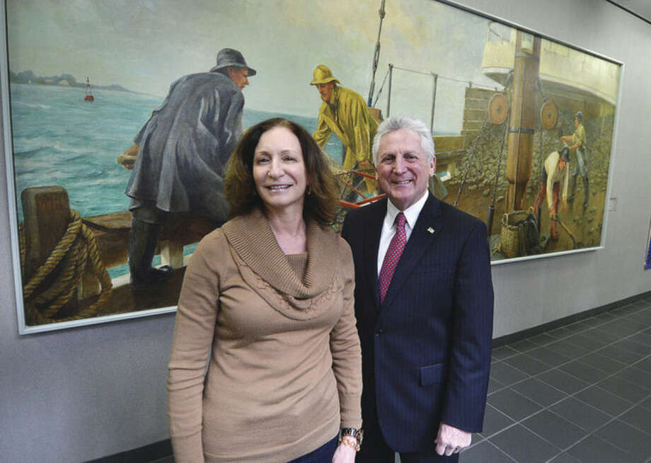 Hour Photo/Alex von Kleydorff Kathryn Hebert and Mayor Harry Rilling near the WPA mural' Dredging for Oysters in City Hall