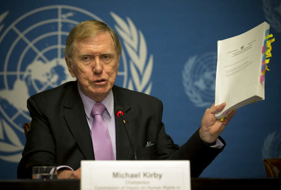 "Retired Australian judge Michael Kirby, chairperson of the commission of Inquiry on Human Rights in the Democratic People's Republic of Korea, shows the commission's report during a press conference at the United Nations in Geneva, Switzerland, Monday, Feb. 17, 2014. A U.N. panel has warned North Korean leader Kim Jong Un that he may be held accountable for orchestrating widespread crimes against civilians in the secretive Asian nation. Kirby told the leader in a letter accompanying a yearlong investigative report on North Korea that international prosecution is needed ""to render accountable all those, including possibly yourself, who may be responsible for crimes against humanity."" (AP Photo/Anja Niedringhaus)"