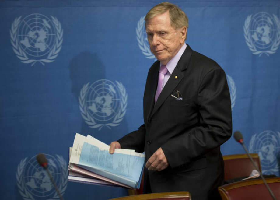 """Retired Australian judge Michael Kirby, chairperson of the commission of Inquiry on Human Rights in the Democratic People's Republic of Korea, arrives with the commission's report for a press conference at the United Nations in Geneva, Switzerland, Monday, Feb. 17, 2014. A U.N. panel has warned North Korean leader Kim Jong Un that he may be held accountable for orchestrating widespread crimes against civilians in the secretive Asian nation. Kirby told the leader in a letter accompanying a yearlong investigative report on North Korea that international prosecution is needed """"to render accountable all those, including possibly yourself, who may be responsible for crimes against humanity."""" (AP Photo/Anja Niedringhaus)"""