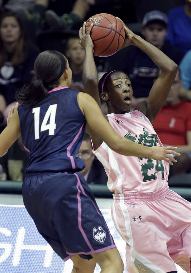 South Florida forward Alisia Jenkins (24) goes up for a shot in front of Connecticut guard Bria Hartley (14) during the first half of an NCAA women's college basketball game, Sunday, Feb. 16, 2014, in Tampa, Fla. (AP Photo/Chris O'Meara)