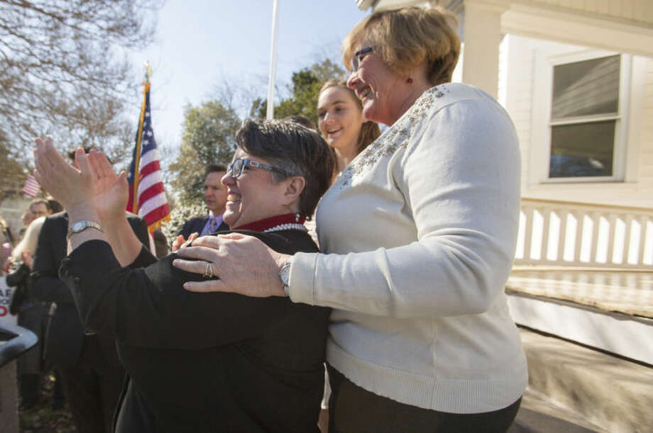 From left: Carol Schall and Mary Townley celebrate Thursday's ruling by federal Judge Arenda Wright Allen that Virginia's same-sex marriage ban was unconstitutional during a news conference, Friday, Feb. 14, 2014 in Norfolk, Va. Wright Allen on Thursday issued a stay of her order while it is appealed, meaning that gay couples in Virginia still won't be able to marry until the case is ultimately resolved. An appeal will be filed to the 4th District Court of Appeals, which could uphold the ban or side with Wright Allen. (AP Photo/The Virginian-Pilot, Bill Tiernan) MAGS OUT