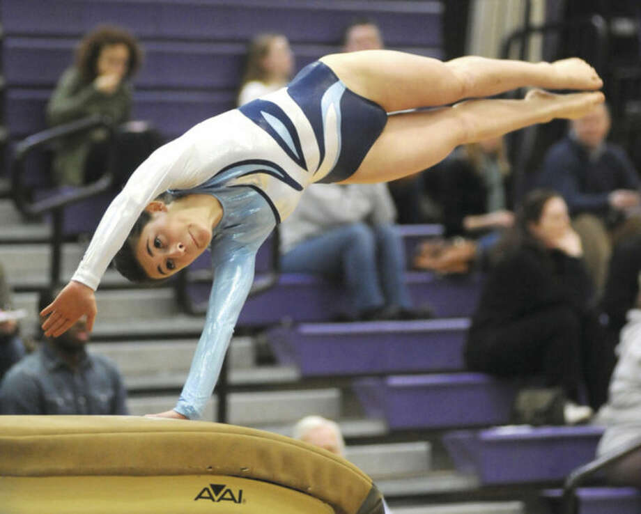 Hour photo/John NashAnnie Saltarelli of Wilton hits the vault during Saturday's FCIAC gymnastics championship meet in Stamford. Saltarelli and the Warriors finished third behind Trumbull and Ludlowe.