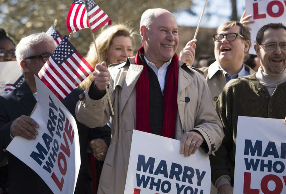 From left: Robert Roman and Claus Ihlemann of Virginia Beach celebrate with Carol Schall, Mary Townley , Tim Bostic and Tony London, Thursday's ruling by federal Judge Arenda Wright Allen that Virginia's same-sex marriage ban was unconstitutional during a news conference, Friday, Feb. 14, 2014 in Norfolk, Va. Wright Allen on Thursday issued a stay of her order while it is appealed, meaning that gay couples in Virginia still won't be able to marry until the case is ultimately resolved. An appeal will be filed to the 4th District Court of Appeals, which could uphold the ban or side with Wright Allen. (AP Photo/The Virginian-Pilot, Bill Tiernan) MAGS OUT