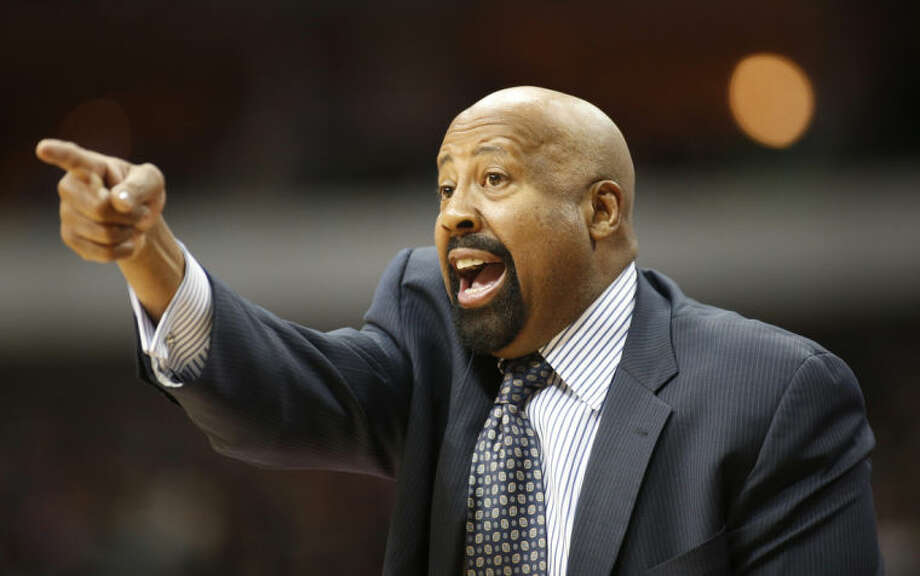 """FILE - In this Jan. 5, 2014 file photo, New York Knicks head coach Mike Woodson gestures during the second half of an NBA basketball game against the Dallas Mavericks in Dallas. The Knicks have fired Woodson after falling from division champions to out of the playoffs in one season. New team president Phil Jackson made the decision Monday, April 21, 2014, saying in a statement """"the time has come for change throughout the franchise."""" (AP Photo/Sharon Ellman, File)"""