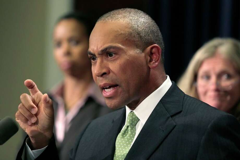Mass. Gov. Deval Patrick gestures during a news conference regarding the Massachusetts pharmacy responsible for the meningitis outbreak during a news conference at the Statehouse in Boston, Tuesday, Oct. 23, 2012. The outbreak of meningitis, an inflammation of the lining of the brain and spinal cord, has sickened nearly 300 people, including 23 who died, in more than a dozen states. (AP Photo/Charles Krupa) / AP
