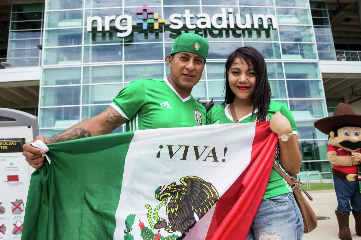 Soccer fans arrive outside NRG Stadium before the Copa America match between Mexico and Venezuela on Monday, June 13, 2016, in Houston.
