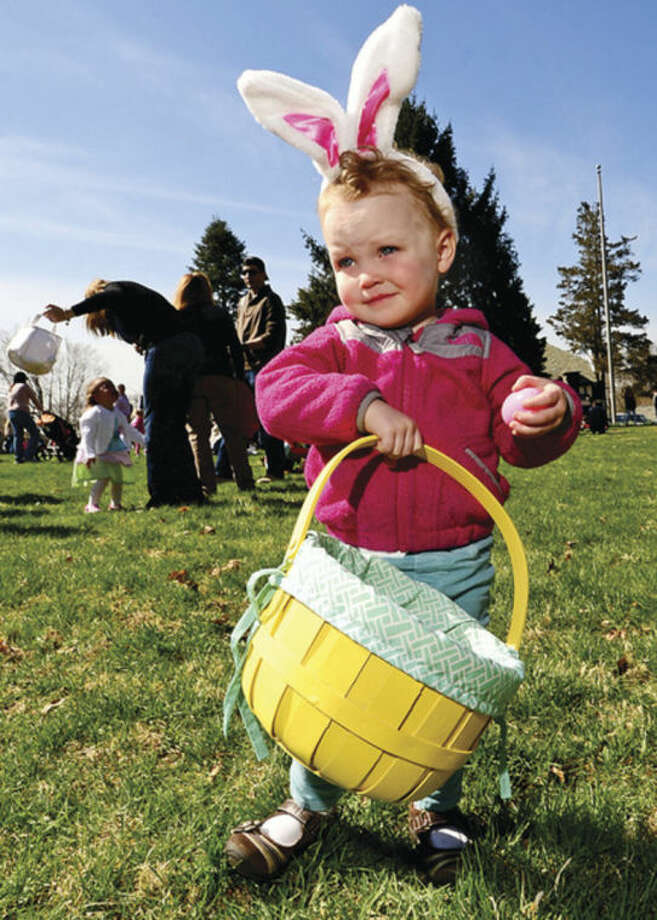 Hour photo / Erik Trautmann 2 year old Beatric Thomas searches for eggs at the Rowayton Civic Association annual Easter Egg Hunt at the Rowayton Community Center Saturday