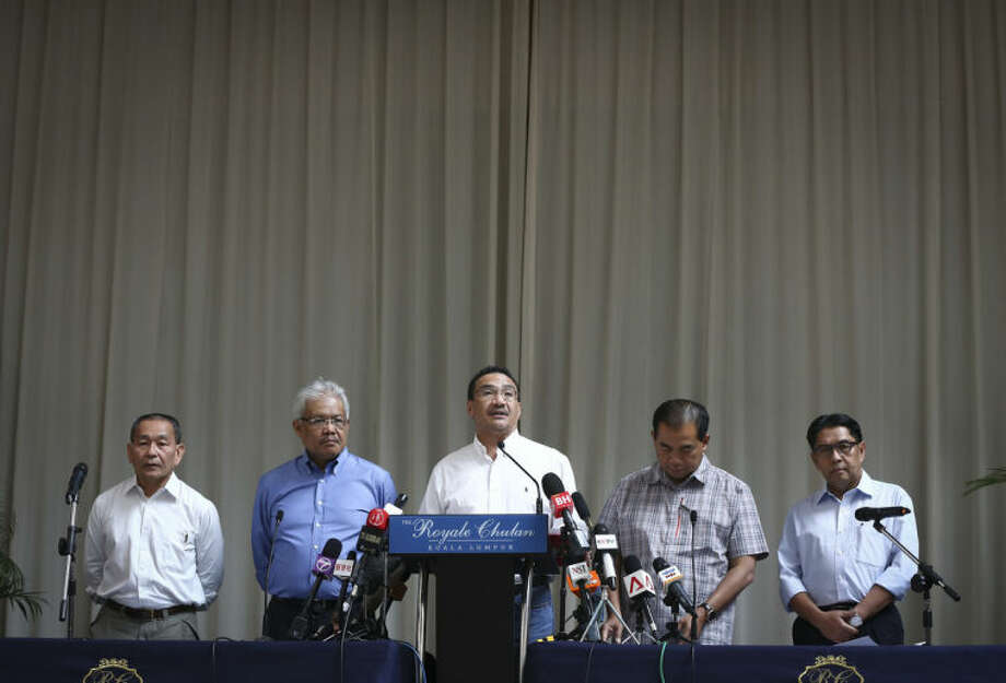 From left to right, Malaysia Airlines Group CEO Ahmad Jauhari Yahya, Deputy Minister of Foreign Affairs Hamzah Zainudin, Malaysia's acting Transport Minister Hishammuddin Hussein, third from left, Deputy Minister, Abdul Aziz Kaprawi and Malaysian Department of Civil Aviation, Azharuddin Abdul Rahman attend a press conference for the missing Malaysia Airline, MH370 at a hotel in Kuala Lumpur, Malaysia, Saturday, April 19, 2014. An underwater robotic submarine is expected to finish searching a narrowed down area of the Indian Ocean seabed for the missing Malaysia Airlines plane within the next week, after completing six missions and so far coming up empty, the search coordination center said Saturday. (AP Photo/Vincent Thian)