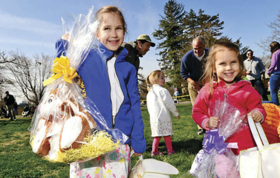 Hour photo / Erik Trautmann Hazel and Alice Stern, 6 and 3, both found golden eggs that earned them a stuffed bunny at the Rowayton Civic Association annual Easter Egg Hunt at the Rowayton Community Center Saturday