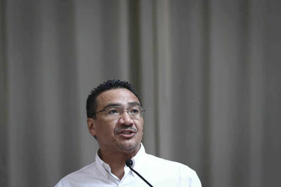 Malaysia's acting Transport Minister Hishammuddin Hussein answers a reporter's questions during a press conference for the missing Malaysia Airline, Flight MH370 at a hotel in Kuala Lumpur, Malaysia, Saturday, April 19, 2014. An underwater robotic submarine is expected to finish searching a narrowed down area of the Indian Ocean seabed for the missing Malaysia Airlines plane within the next week, after completing six missions and so far coming up empty, the search coordination center said Saturday. (AP Photo/Vincent Thian)