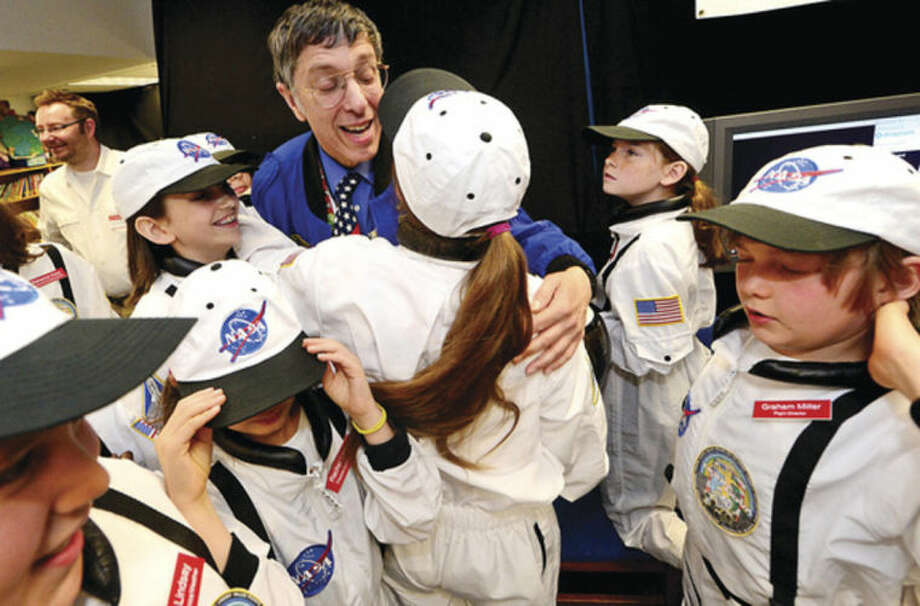 Hour photo / Erik Trautmann Teacher and Mission Commander and Chief Andrew Pearce celebrates with his astronauts as Columbus Magnet School observes the 19th annual Young Astronaut mission, Terra Nova simulated landing at Friday morning.
