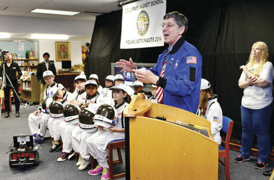 Hour photo / Erik Trautmann Teacher and Mission Commander and Chief Andrew Pearce addresses his astronauts as Columbus Magnet School observes the 19th annual Young Astronaut mission, Terra Nova simulated landing at Friday morning.