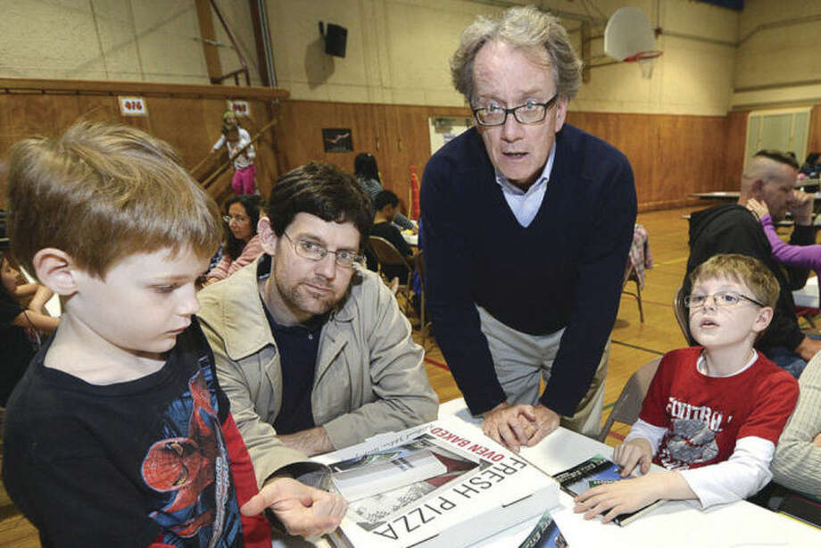 Hour Photo/Alex von Kleydorff 'Winner Takes All' Author Fred Bowman talks with Tristan Meyer-Mitchell, Dad Merlin and Charlie Horner during a program at Cranbury School