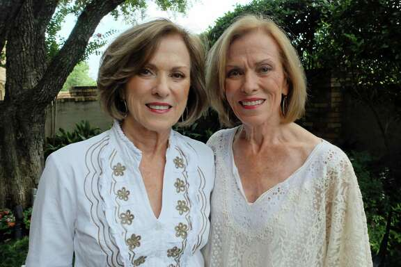 "Twins Marilyn Wells, left, and Carolyn Pool at Wells' Houston home on June 13, 2016. They are the subjects of ""Twins on Street, Downtown,"" a photograph taken without their knowledge in 1957, when they were 17, by Henri Cartier-Bresson. The image is on view at the Menil Collection."