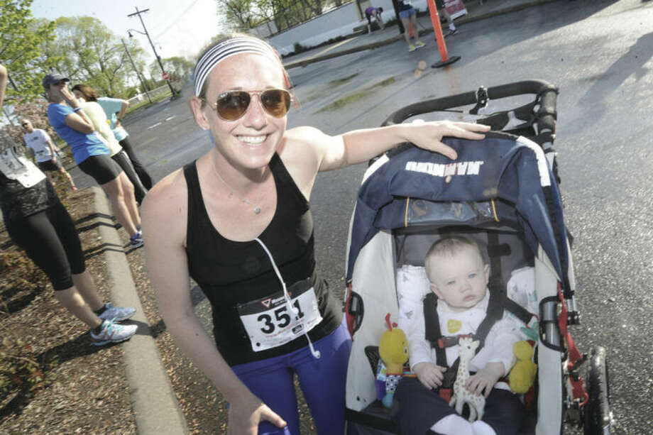 New Mom Laura Czegledi with her 8 month old son Michael at the annual Mothers Day 10 K race at Calf Pasture Beach. Hour photo/Matthew Vinci