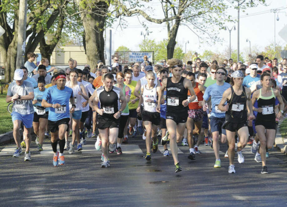 The annual Mothers Day 10 K race at Calf Pasture Beach. Hour photo/Matthew Vinci